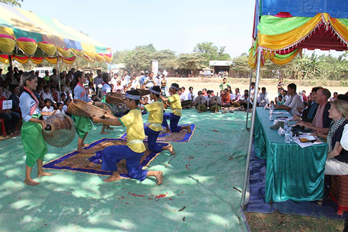 "Children perform ""Fishing Dance"" to entertain all participants during the celebration."