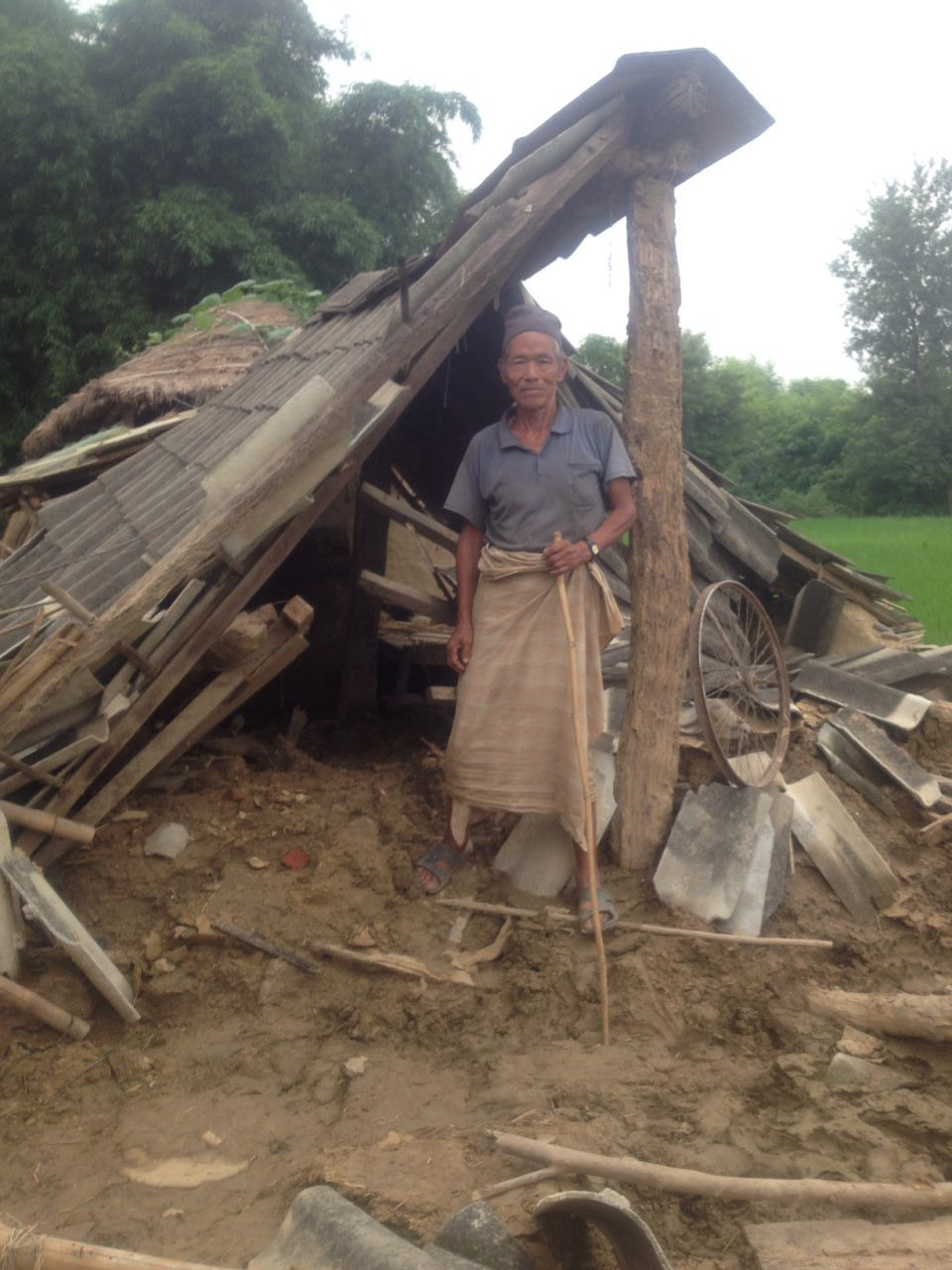 Farmers in Nepal amid the ruins of their houses.
