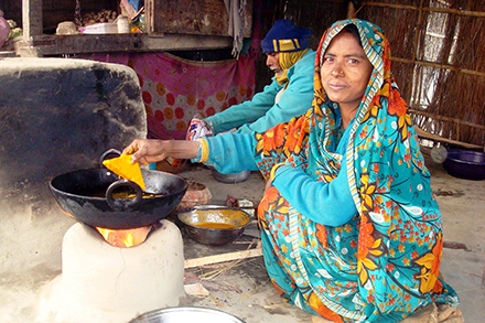 Renu makes Pakoda (snacks) in her shop while her husband assists.